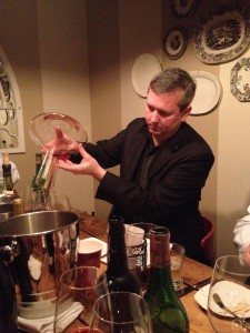 Dinner organizer Ken Brown carefully pours Haut Brion 1971